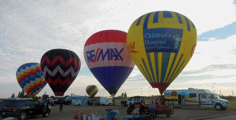 Cheers and RE/MAX balloons at Color the Skies