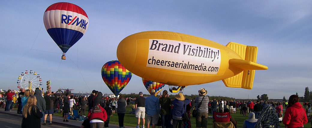 Amelia Airship with RE/MAX Balloon - Cheers Aerial Media